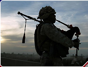 Marine plays bagpipes in Fallujah.jpg
